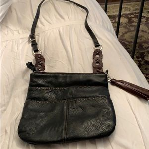 A brown cross body adjustable purse